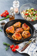 roasted chicken thighs with vegetable side dish scaled