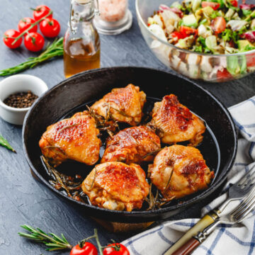 Roasted Chicken Thighs with salad side dish ready to eat