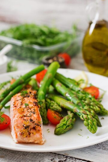Instant Pot Salmon and asparagus for two, ready in under 15 minutes; plated and ready to serve.
