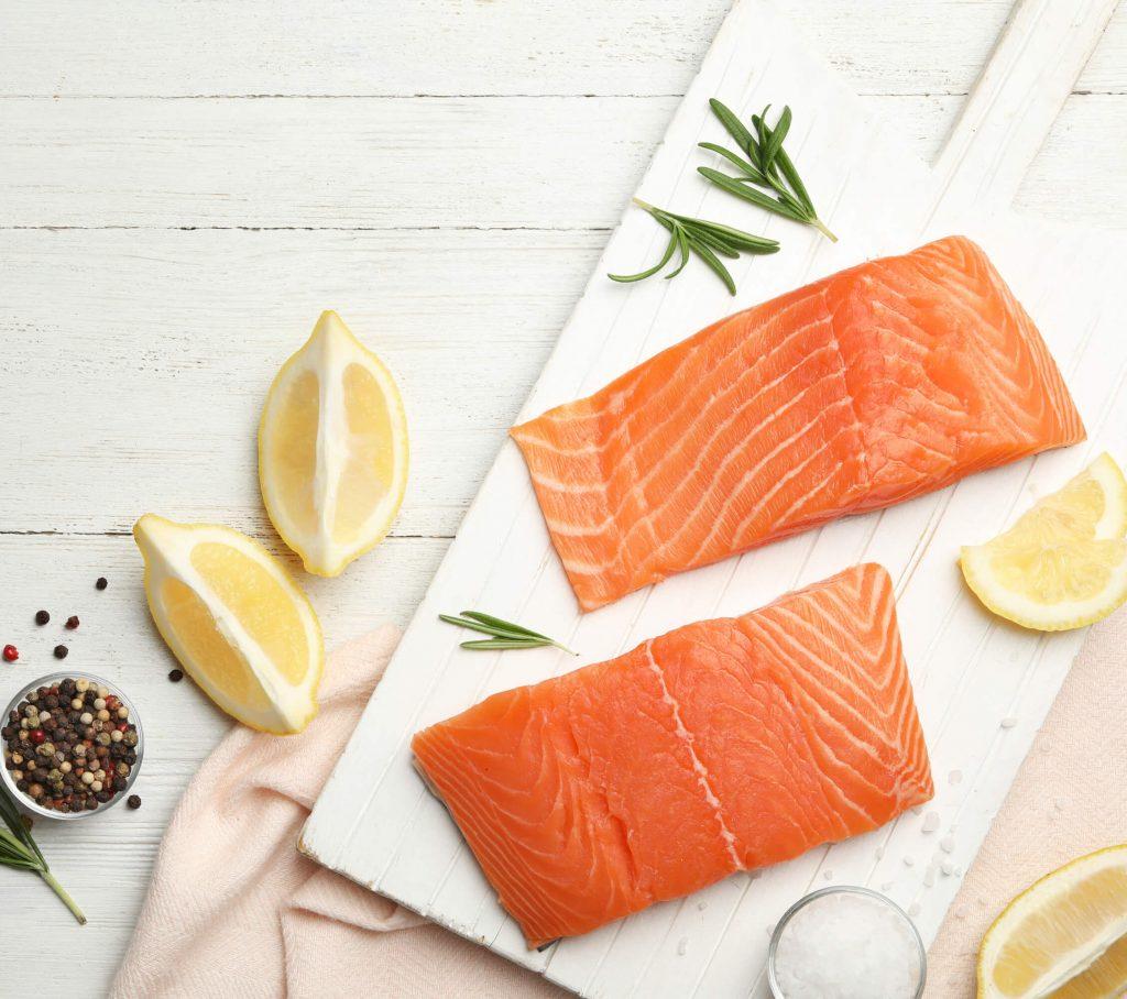 Salmon Fillet and Seasonings of lemon, salt, pepper, rosemary