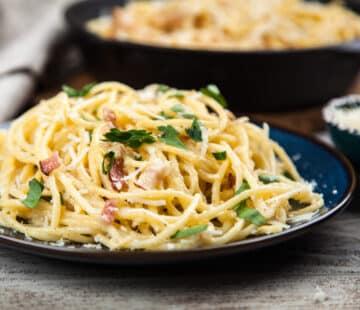 spaghetti carbonara with parmsan closeup scaled