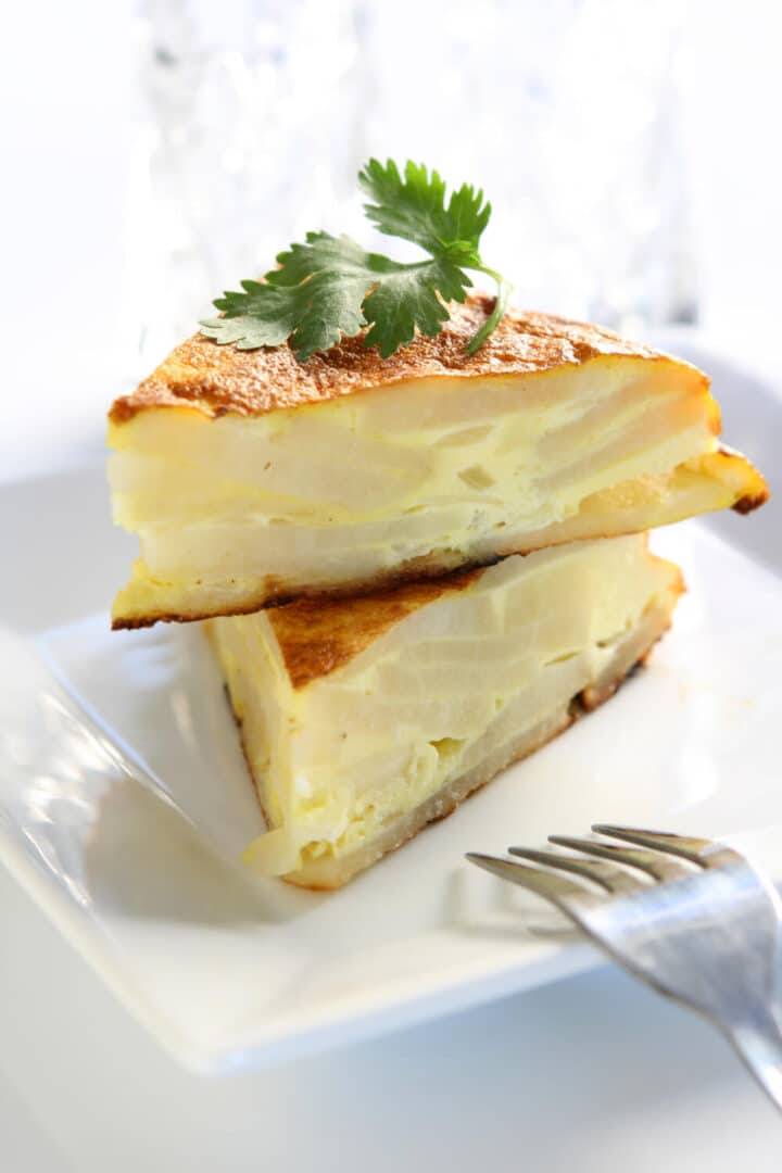 Spanish Omelette cut into wedges and ready to eat.