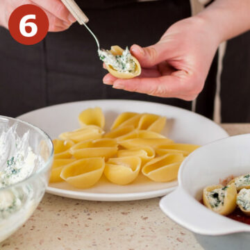 Stuffing shells with cheese mixture